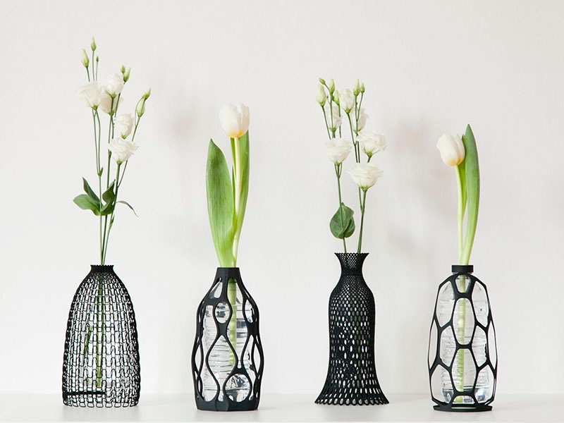 From left: DesignLibero's Knitted vase, Sinuous vase, Lace vase, and Spider vase.