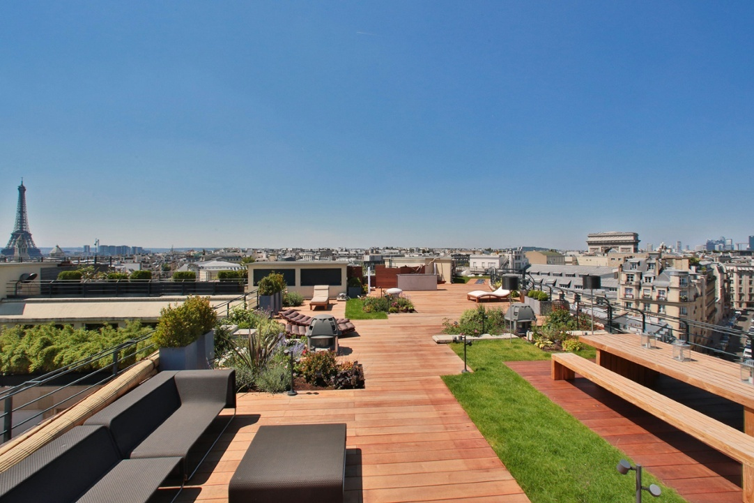 This contemporary duplex penthouse enjoys a prime position in a 1930 landmark building, just steps from the Arc de Triomphe. Residents are within a short walk of several of the city's convenient Vélib (bicycle) stations.