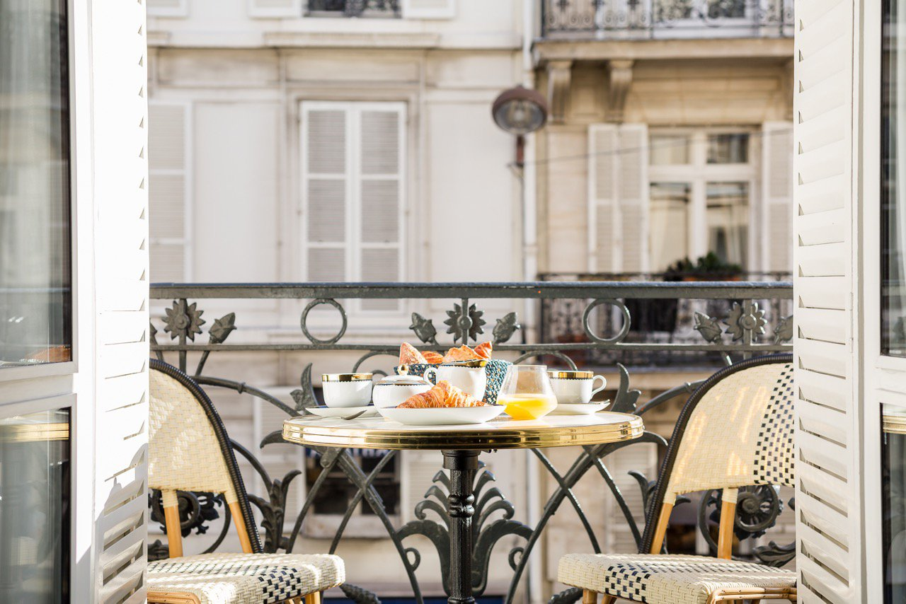 This second-floor apartment in the 6th Arrondissement, near Luxembourg Gardens, is the quintessential Parisian pied-à-terre. The home's charming breakfast patio overlooks Rue Bonaparte, home to France's famous Pierre Hermé pâtisserie.