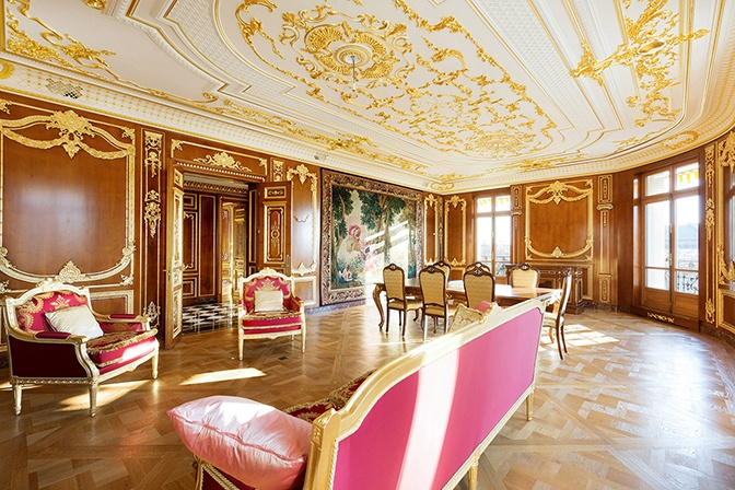 This Parisian residence's museum-quality finishes include decorative plaster ceilings embellished with rosettes and gold leaf moldings.