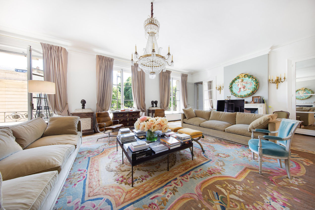 A gracious neighborhood on the stylish and charming Left Bank is the setting for this grand Parisian apartment with windows worthy of the monumental view.