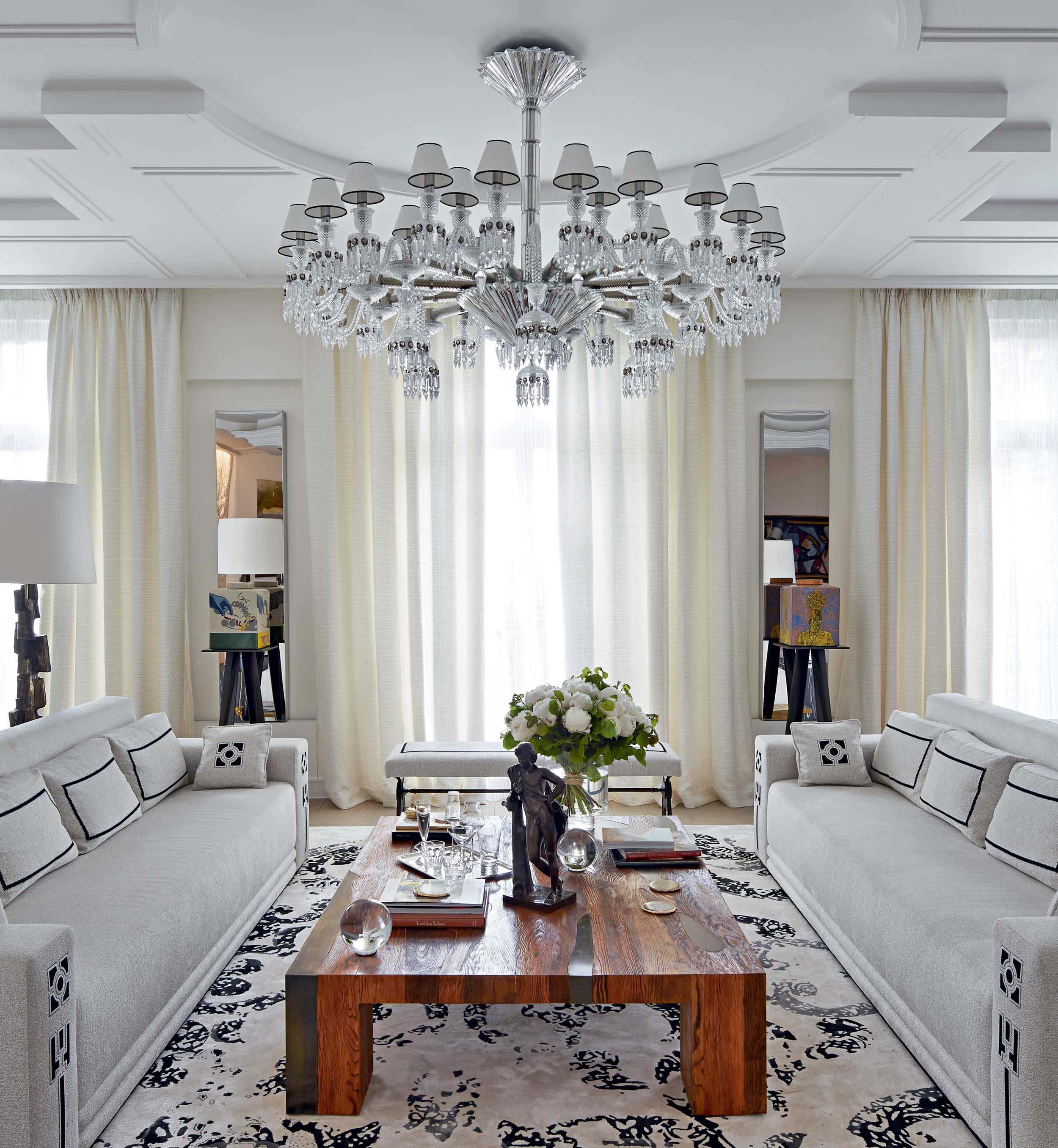 """Stéphanie Coutas, designer of the apartment's current guise is known for her """"contemporary grand"""" style, an aesthetic that chimes with the classic proportions and period details of this four-bedroom apartment, which now has the cachet of a stylish Parisian palace."""