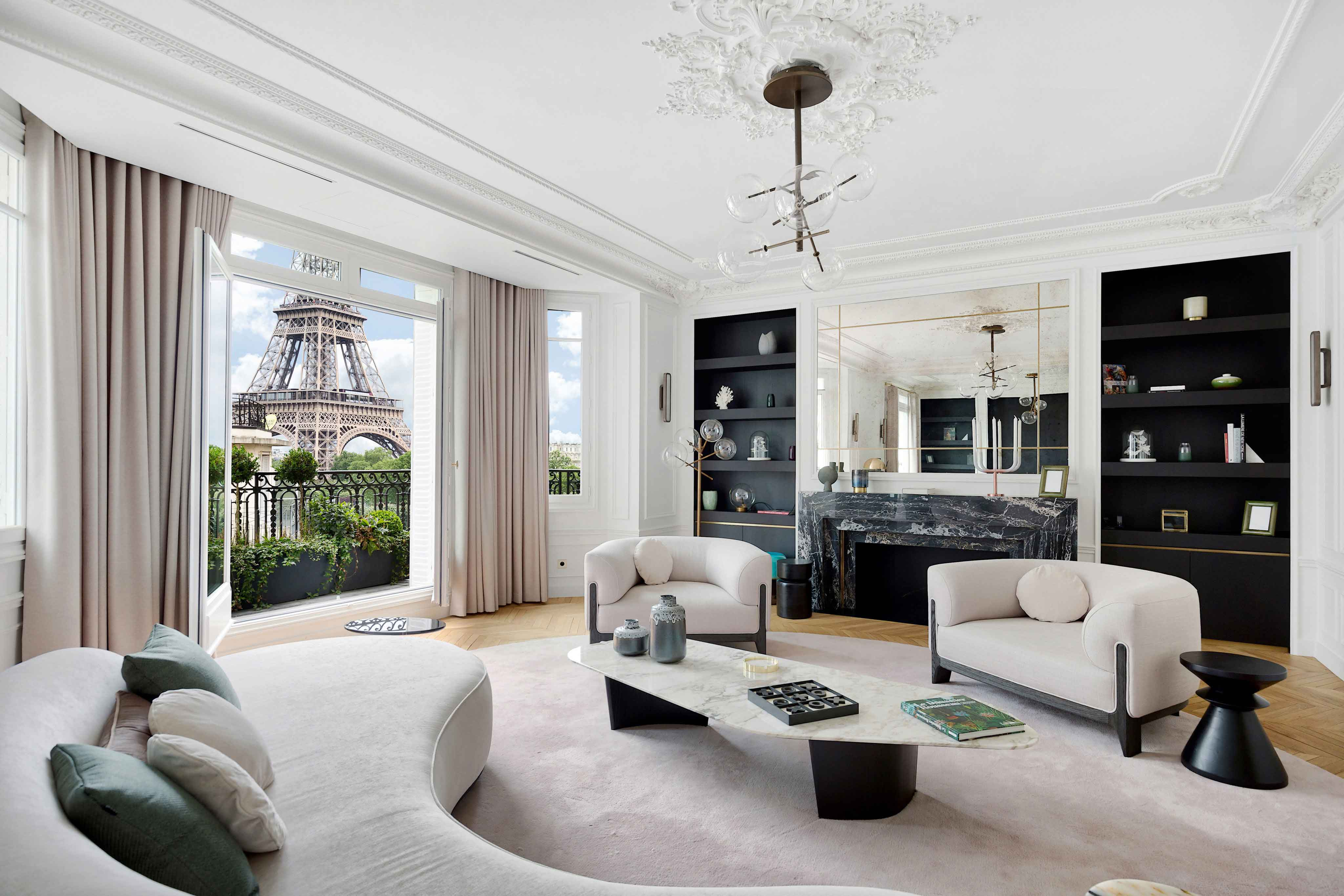 The Eiffel Tower is the dramatic backdrop to this chic apartment in the 16th arrondissement of Paris.