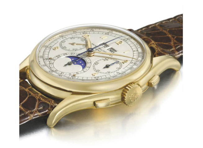 A unique and historically important Ref. 1527 Patek Philippe (1943) 18k gold perpetual calendar chronograph wristwatch with moon phases, which sold for $5,708,885 at Christie's Geneva in 2010.