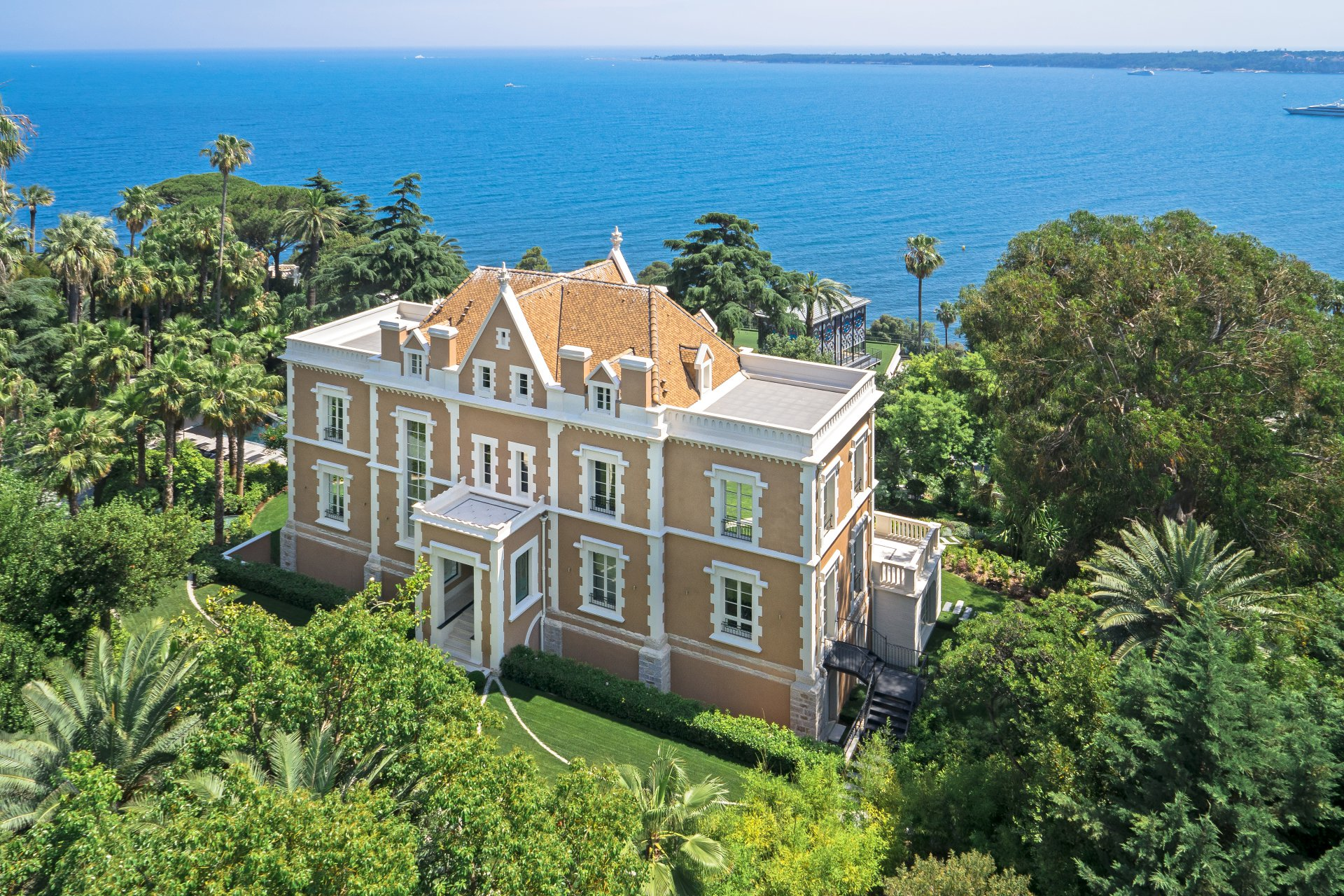 Château Soligny is a magnificent neoclassical castle on two acres of landscaped parkland with panoramic views of the Lérins Islands, Cap d'Antibes, Esterel mountains, and the bay of Cannes.