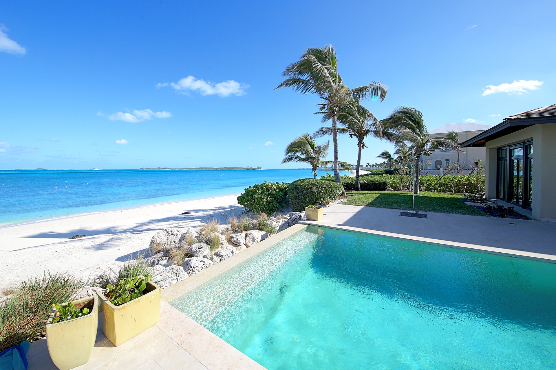 An infinity pools serves as a seamless portal to the secluded beach beyond.