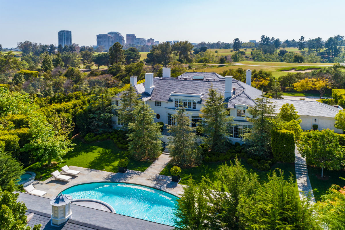 This westward view emphasizes the home's proximity to the Los Angeles Country Club.