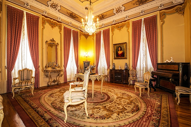 This Portuguese palace abounds with ornate living spaces crowned by vaulted, wood-beamed, and frescoed ceilings.