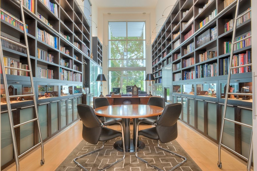 This modern home's library also serves as a spacious study and meeting area.