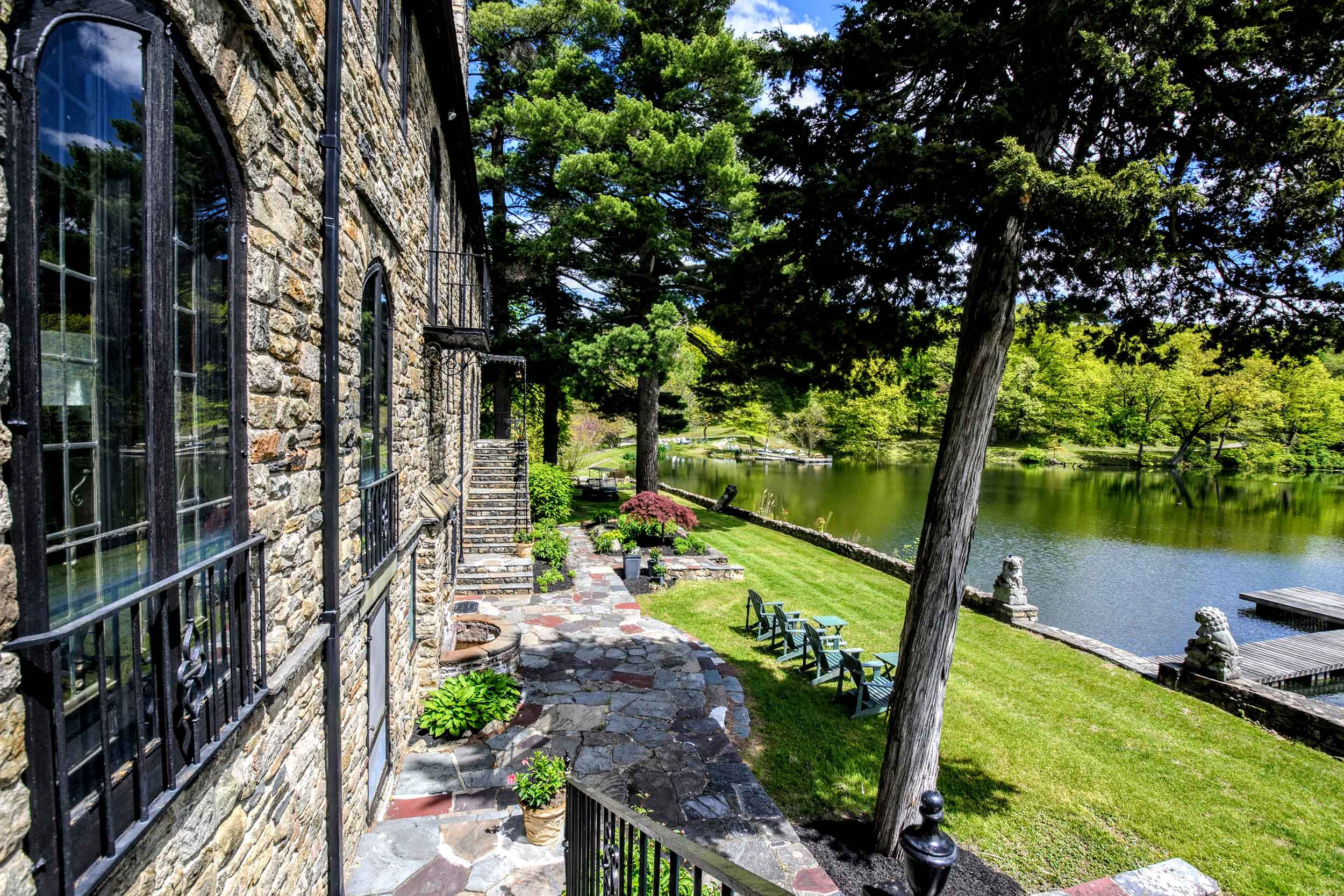The centerpiece of this historic estate is a mansion built from locally sourced Fieldstone and native woods.