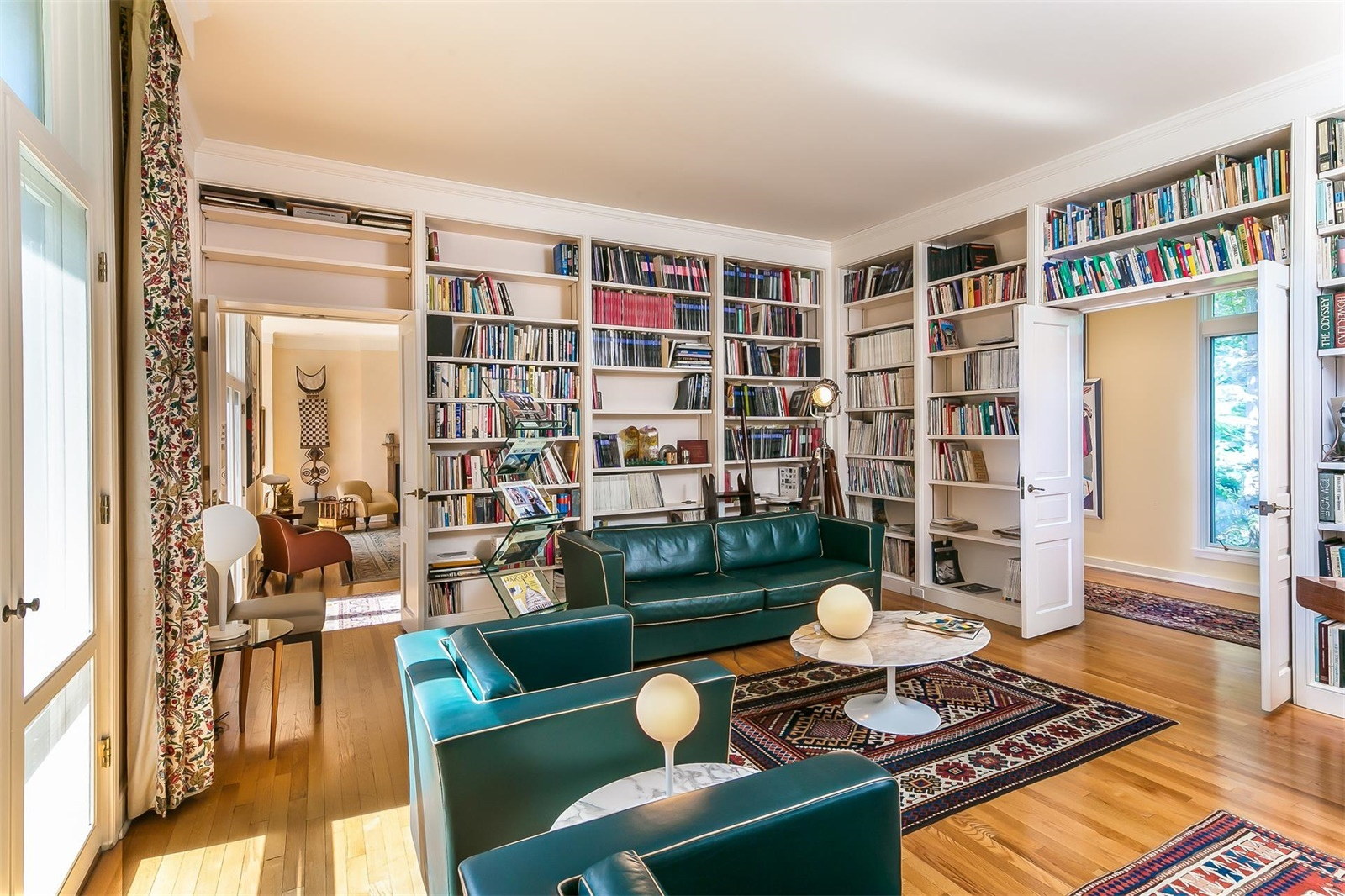 La Maison de Verre's Frank Lloyd Wright-inspired design invites casual living and grand-scale entertaining. A hallway connects the reception areas to an open-plan library and study overlooking the walled gardens.