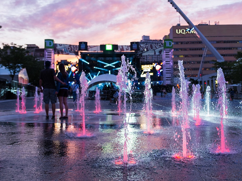 The Quartier des Spectacles hosts more than 40 festivals annually, is home to over 80 performance spaces, and offers some of Montréal's most upscale accommodation and dining options. After dark, the area comes alive with buildings lit up with projections by local artists.
