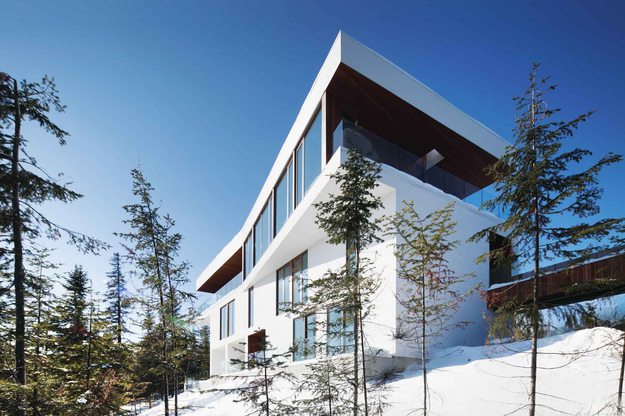 The recipient of a Nobilis prize for architecture, the St. Lawrence Estate, a contemporary ski retreat in Quebec's Massif valley, was designed by Bourgeois/Lechasseur architects in 2014.