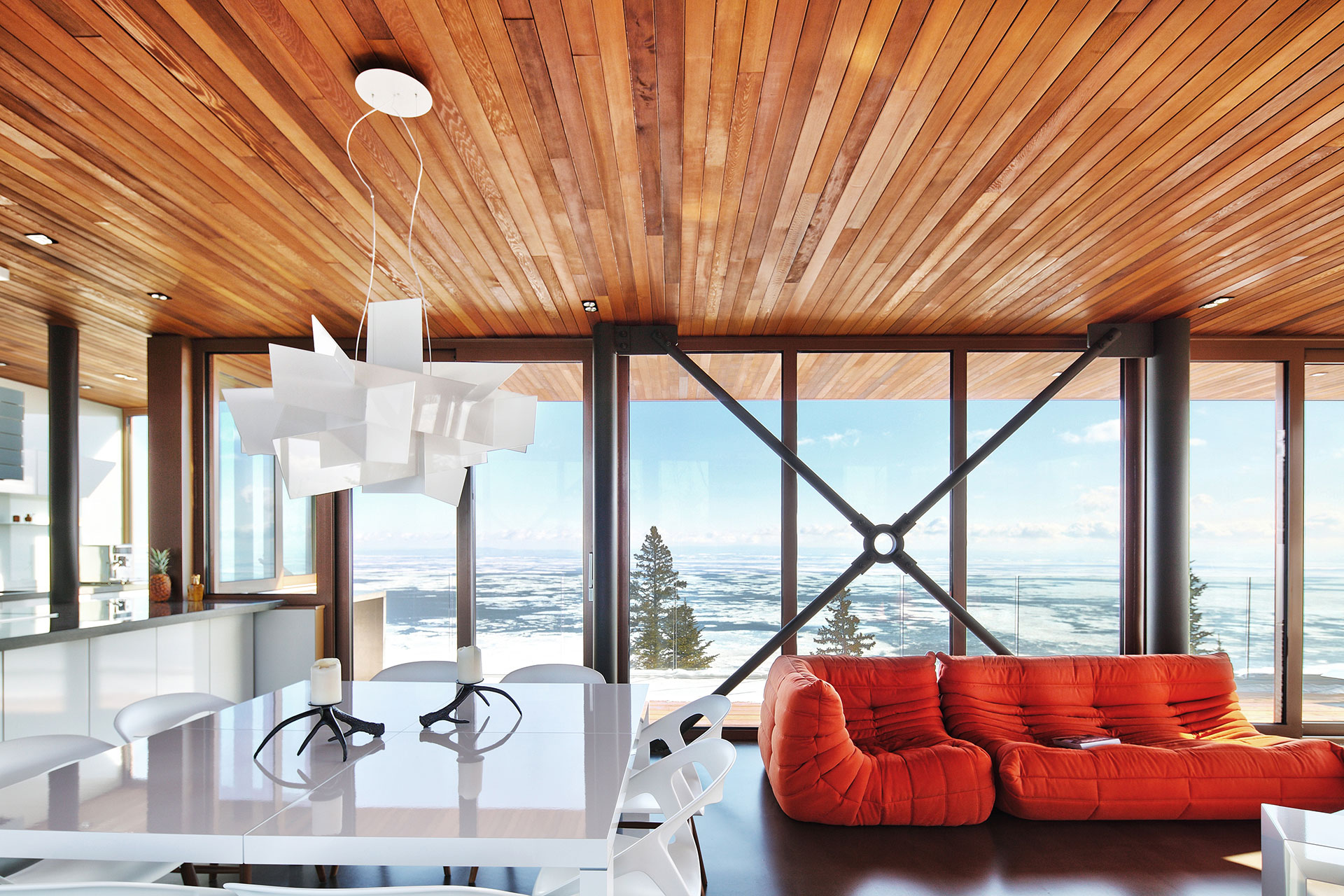 Perched on a promontory overlooking the St. Lawrence River, in Charlevoix, Quebec, this deftly designed home redefines the ski chalet for the 21st century.