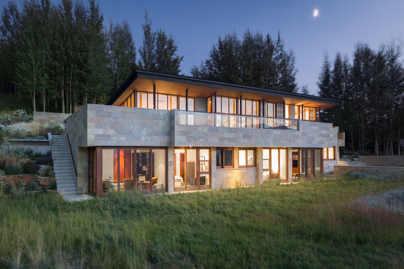This three-tiered luxury mountain ranch home is dramatically built into a hillside overlooking Wyoming's spectacular Gros Ventre Wilderness.