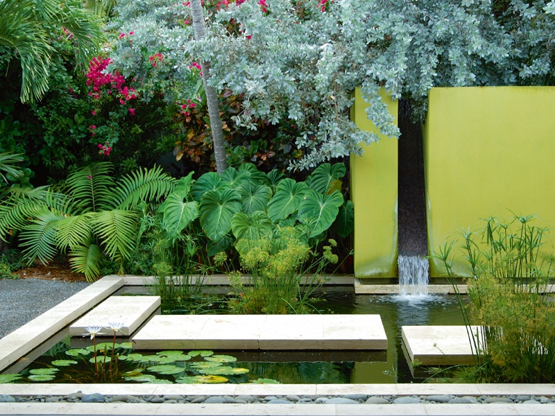 "A series of ""floating"" slabs forms a walkway across this water garden, part of the Island Modern project by Raymond Jungles at a family retreat in Key West, Florida. Photograph: Lanny Provo"