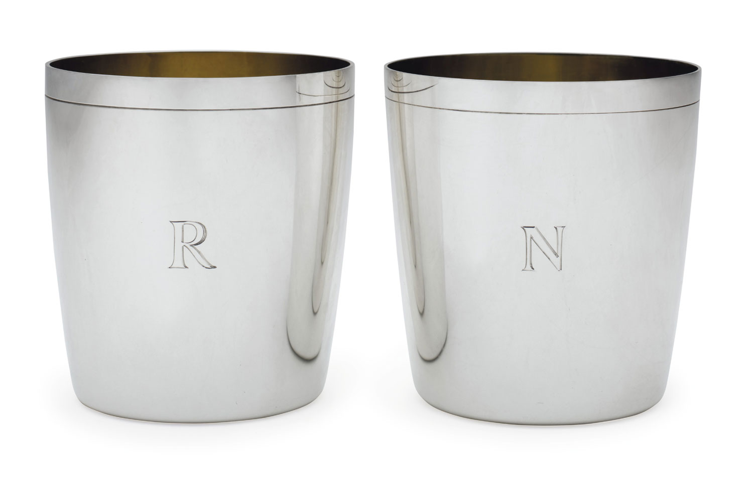 Each beaker is engraved on the outside with the initial R or N.