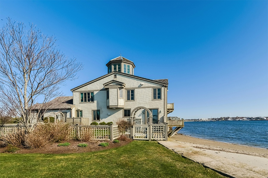 This four-bedroom estate is located in a resort-style waterfront community on Goat Island in Newport Harbor.