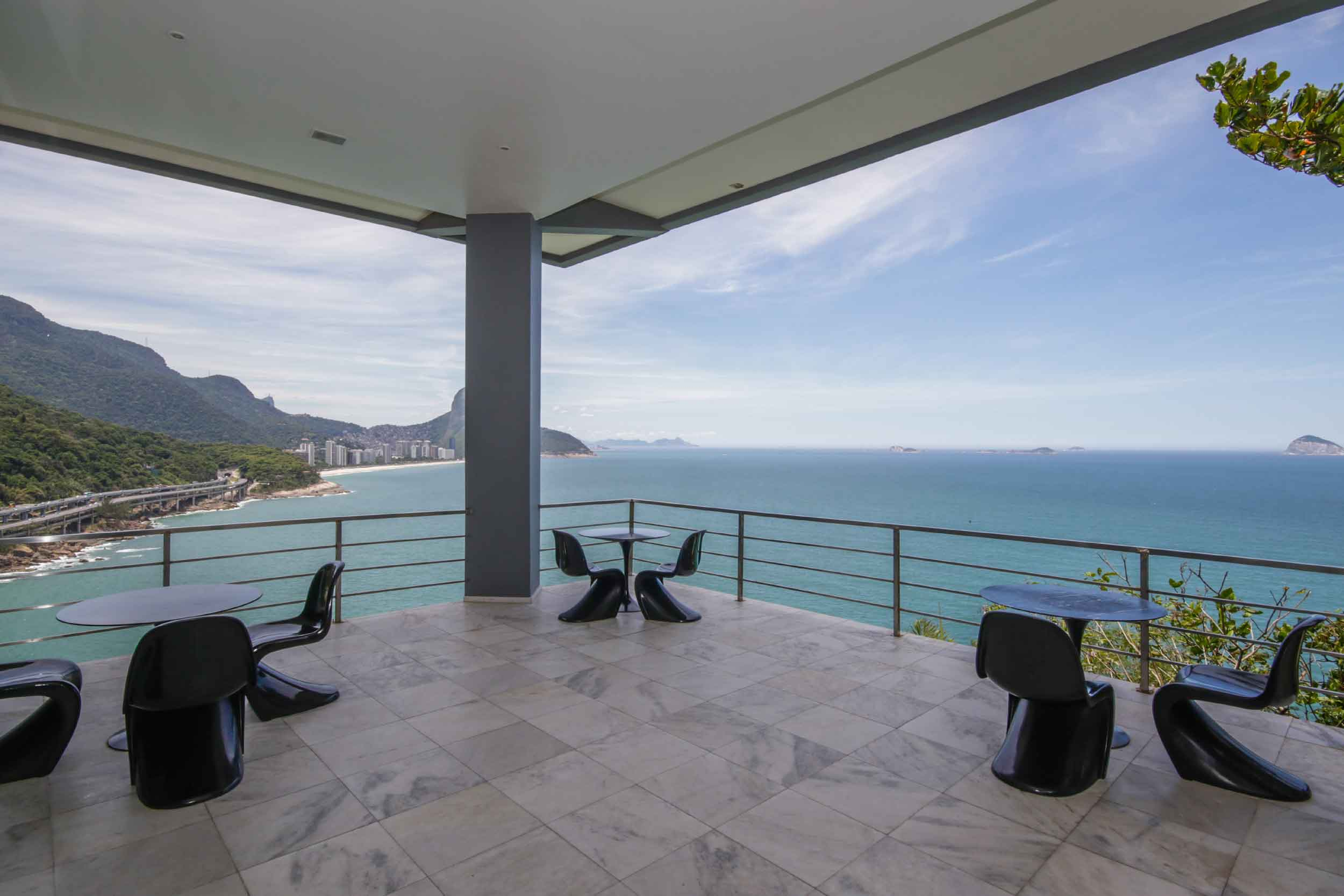 This luxurious eight-bedroom home offers resort-style living in the heart of Rio's Joá neighborhood.