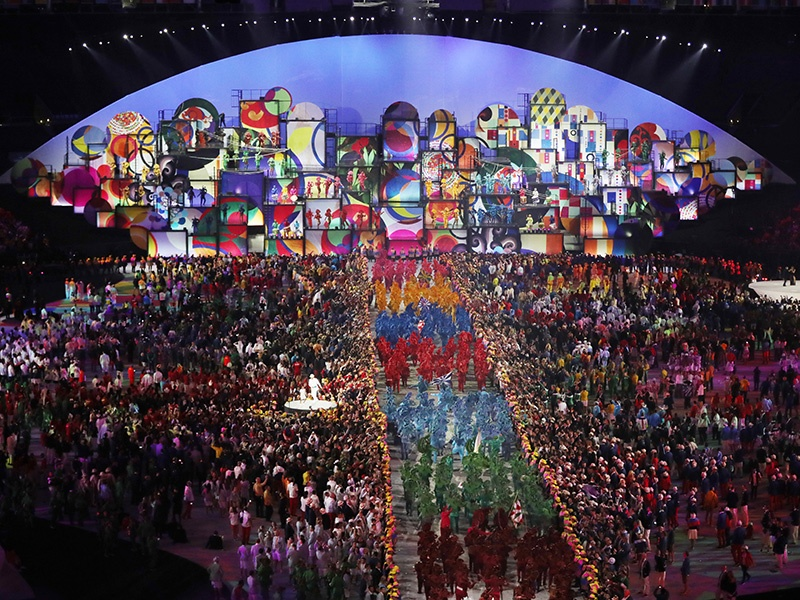 Athletes and artists gather during the 2016 Olympic Games opening ceremony at the Maracanã Stadium in Rio. Photograph: Getty Images. Banner image: Copacabana beach. Photograph: Alamy