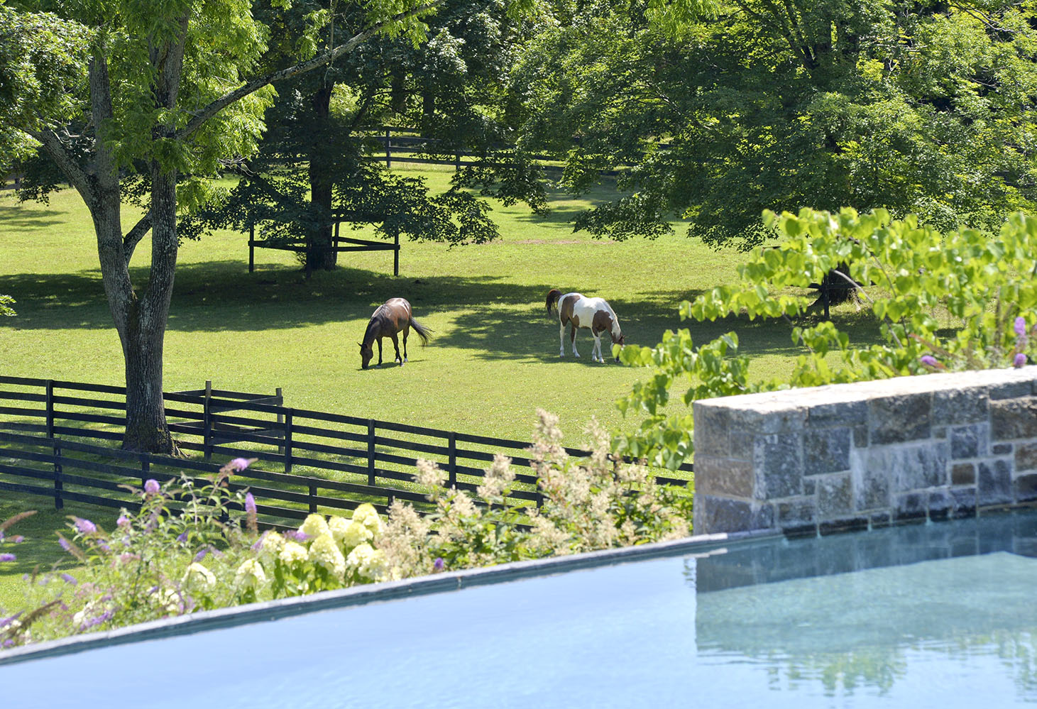 River Oak Farm has an array of facilities for sports lovers of all stripes: a 20-stall barn, riding arena, paddocks and trails, soccer field, basketball court, tennis court—plus an infinity pool and spa in which to relax after the games.