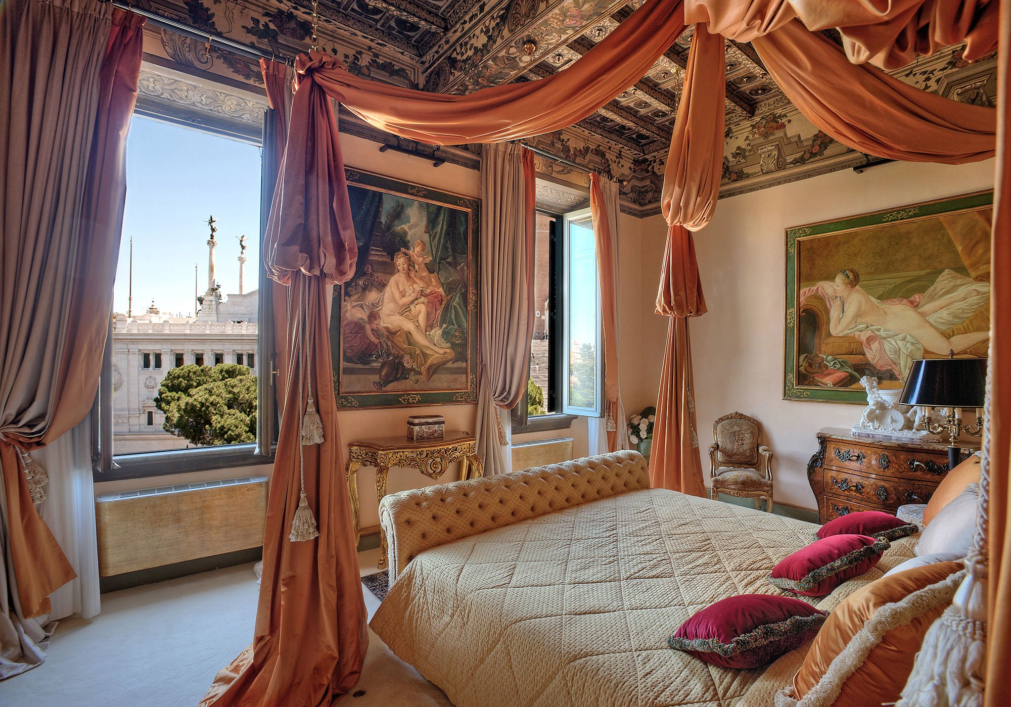 Housed in a former palace built in the 15th-century, the residence is a feast for the eyes both inside and out. The master bedroom is a sensory delight with its dramatic coffered and beamed ceiling, four-poster bed, and dressing room.