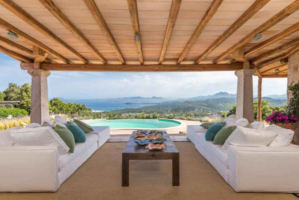 A sweeping vista from this hillside villa on Italy's Emerald Coast takes in the scenic seaside towns of Cala di Volpe, Licia Ruja, and Porto Rotondo.