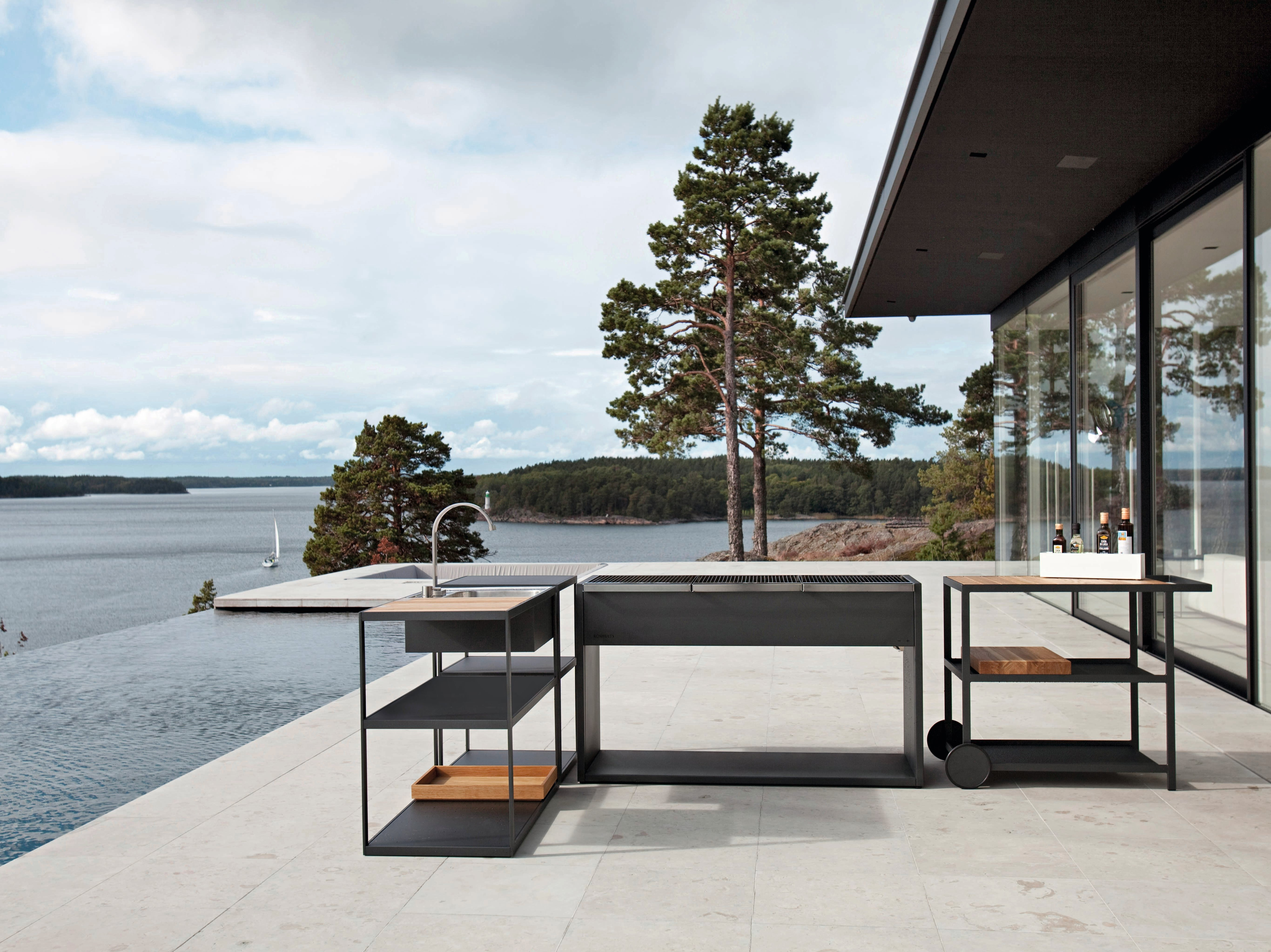 Minimalist design from Röshults gives an airy feeling that echoes the clean lines of this modernist home's exterior.