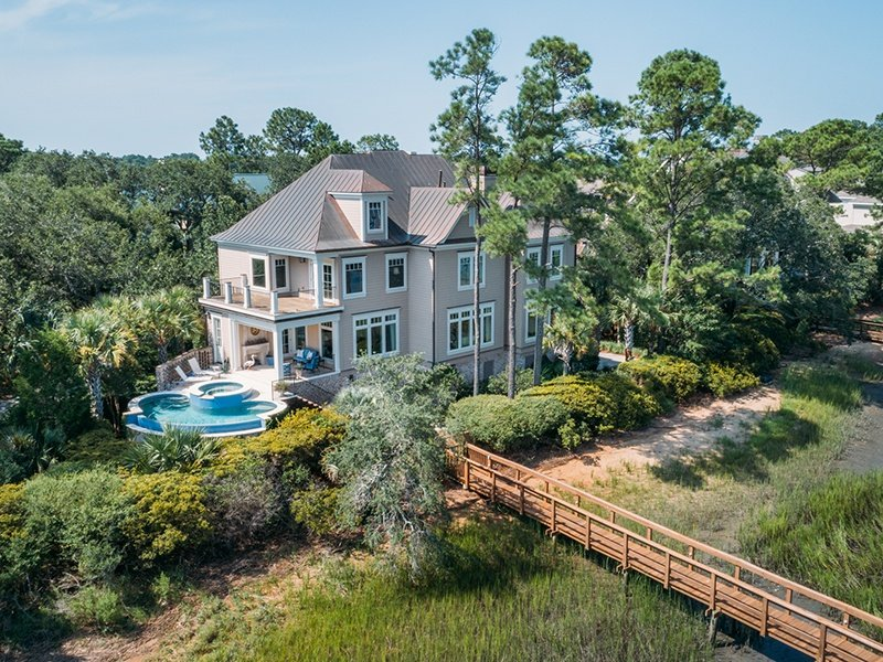 Elegant Australian cypress wood floors, soaring ceilings, and a pool with panoramic views of the Kiawah River are just three of the benefits of owning this stunning five-bedroom property in Kiawah Island, South Carolina.