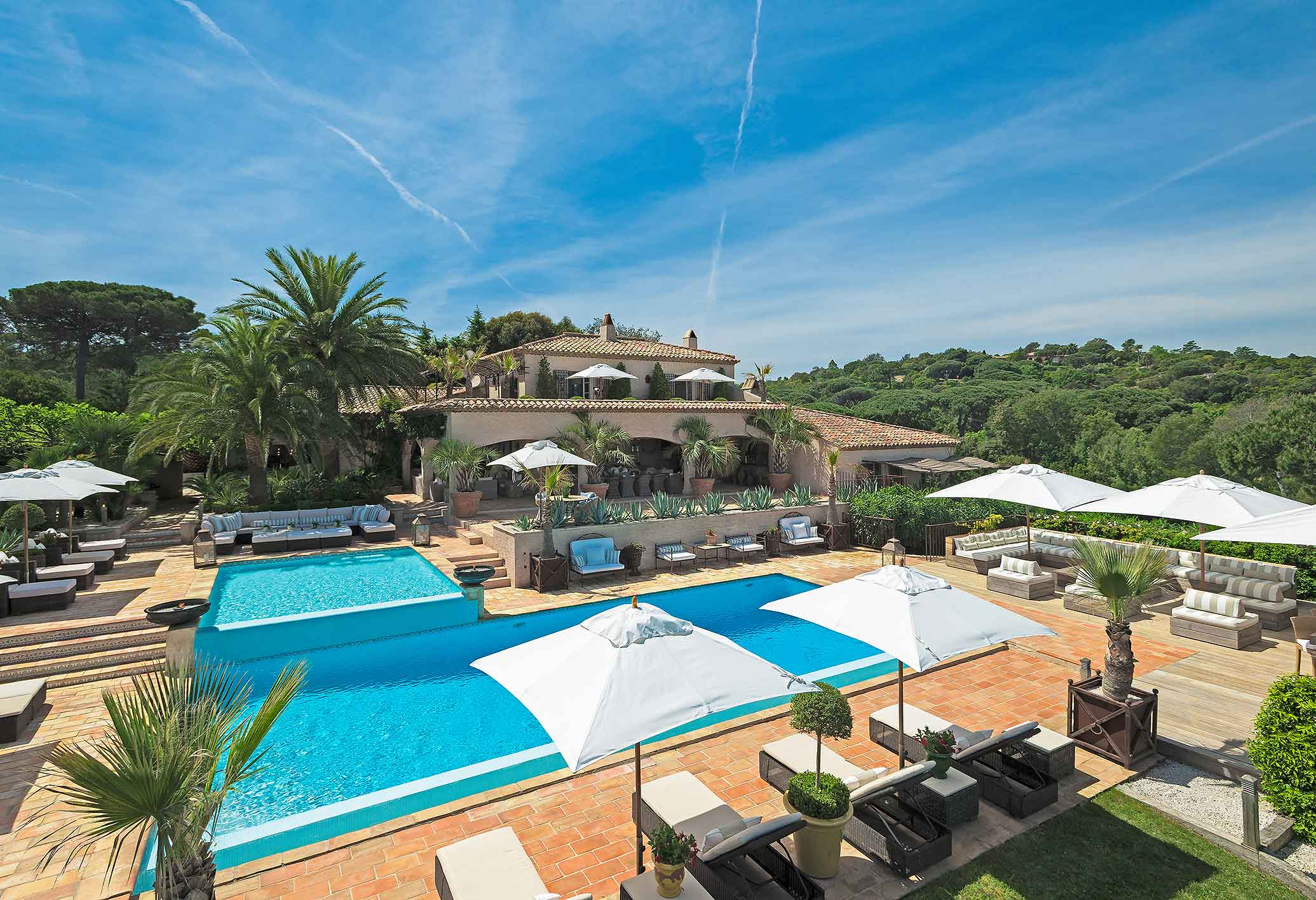A Provençal-style dream with chic Saint-Tropez flair, Villa Salmanazar rests amid privacy and seclusion in the hills of Ramatuelle, overlooking the famous bay of Pampelonne and the legendary resort town of Saint-Tropez.