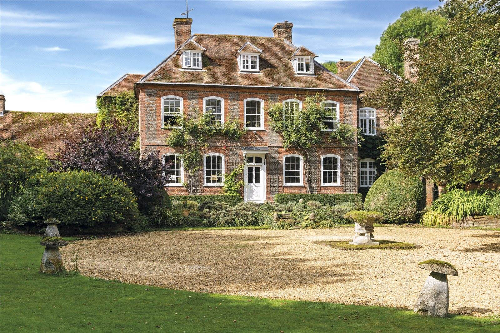 The Manor House is a Grade II listed Queen Anne baroque house on 23 acres of grounds in Salisbury, England. The house is built of red and blue brick in English bond with red brick quoins on the front elevation.
