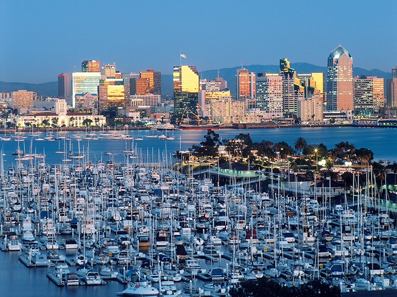 Downtown areas around San Diego Harbor, such as Little Italy, the Ballpark District, and the Gaslamp Quarter, draw visitors and locals alike. Photograph: Getty Images