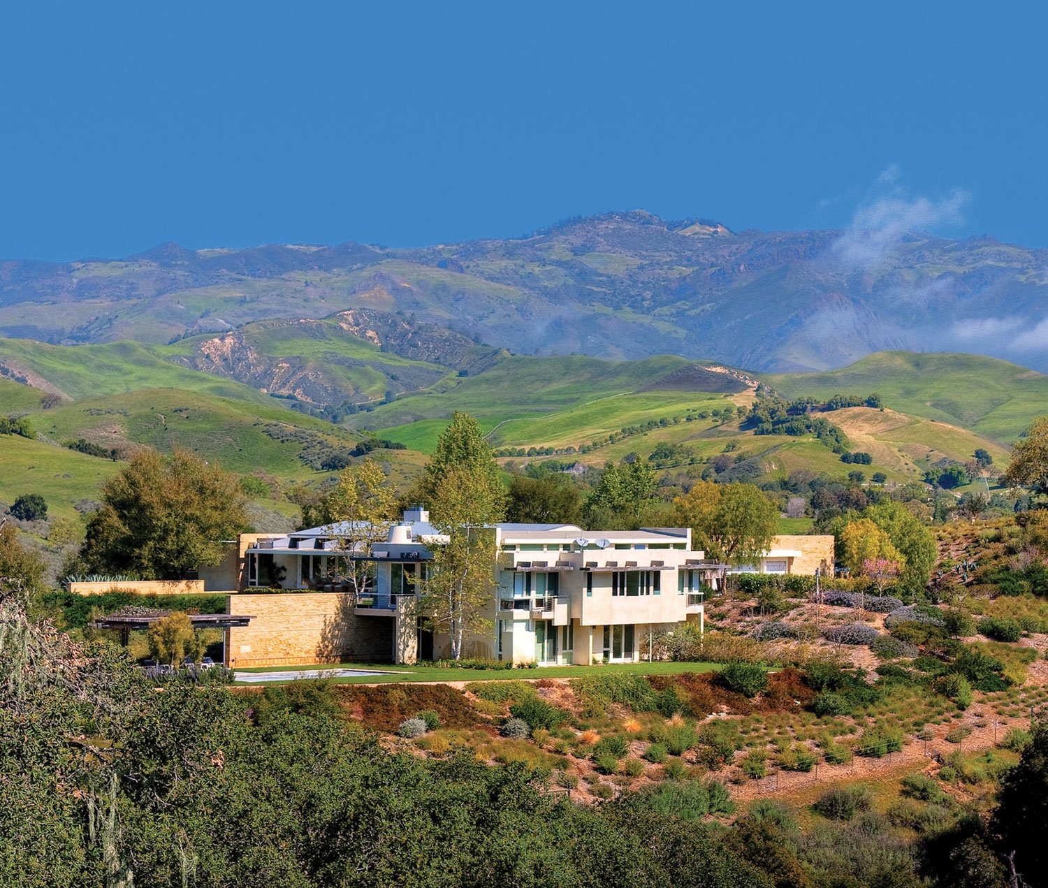 This architecturally significant modernist house and equestrian facility is set within 116 private acres of ranchland in the Santa Ynez Valley.