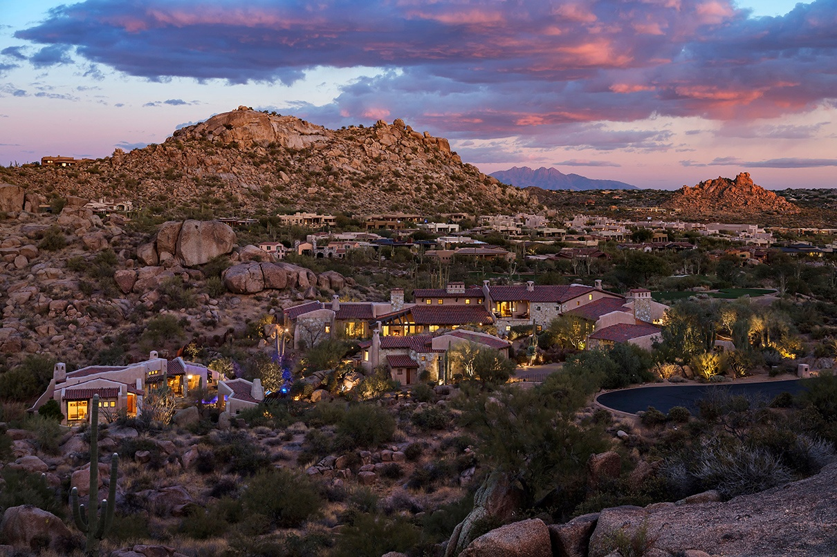 Built into the boulders, this adobe compound is in harmony with the Sonoran Desert landscape.