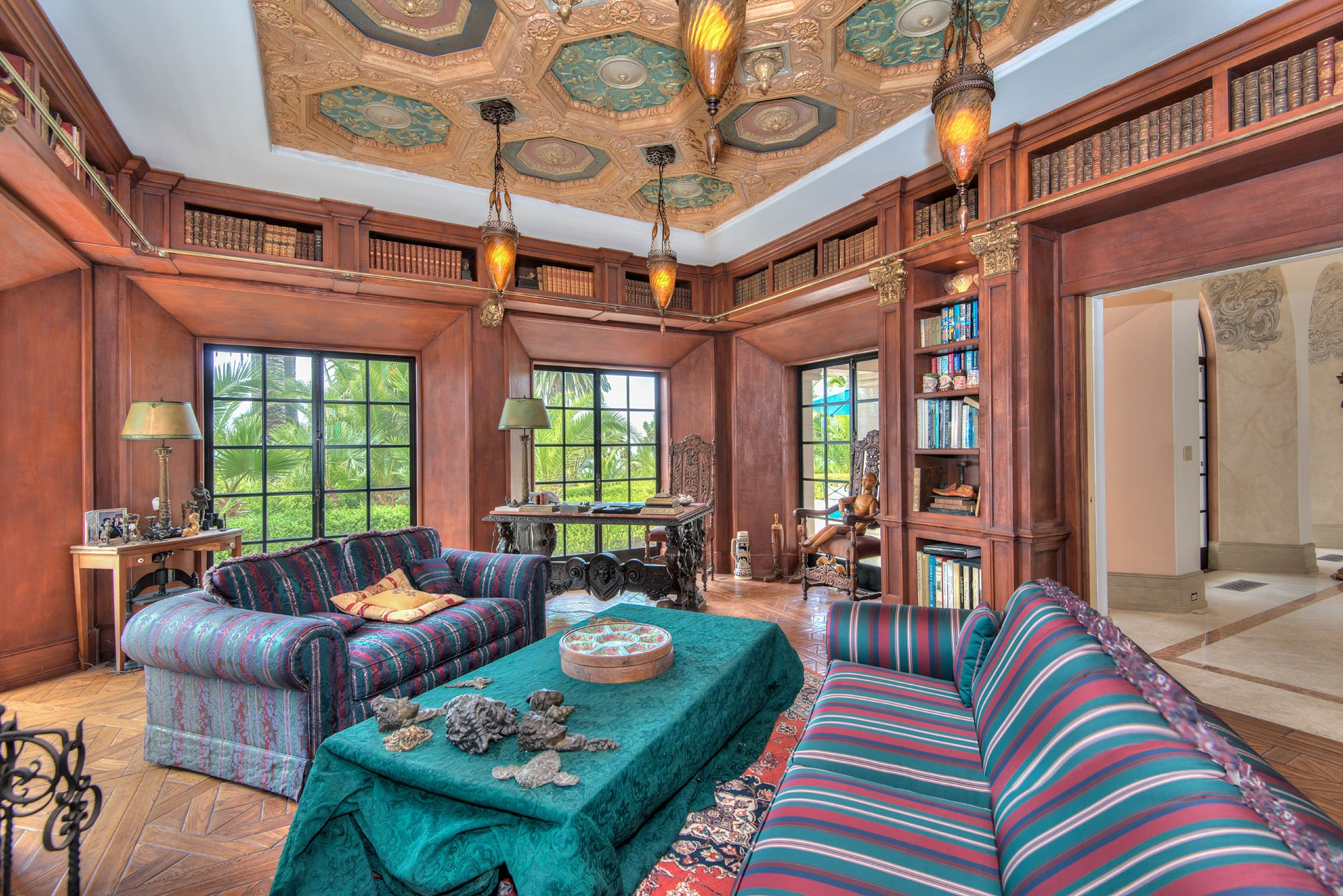 This beautiful Italian-inspired villa in Rancho Palos Verdes, California, has a spectacular wood-paneled library with a secret passage beyond the bookcases.