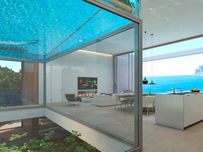 At this family home in the south west of Mallorca, architecture firm Joan Miquel Seguí created a glass box within the living and dining space, through which the swimming pool is clearly visible.