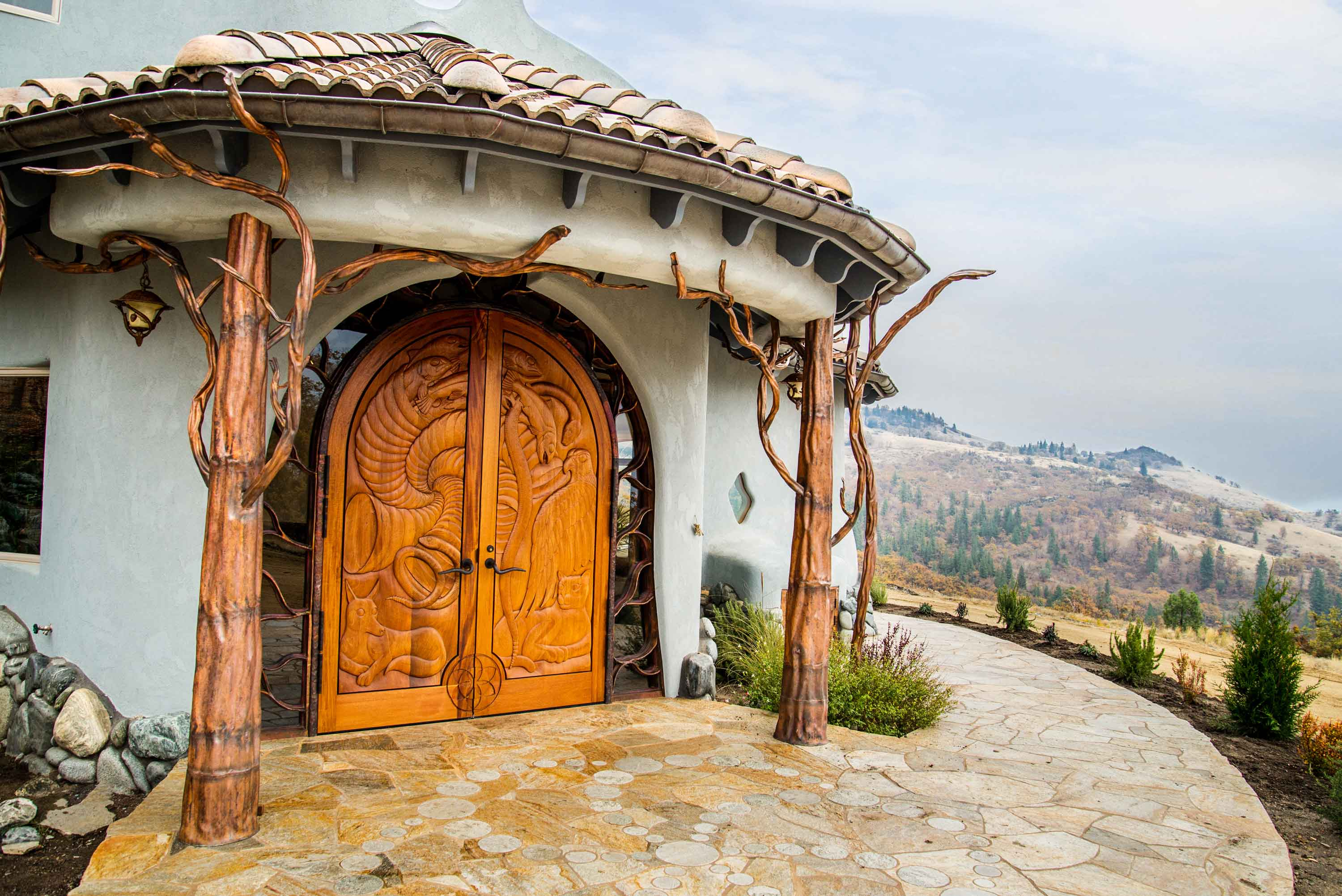 The striking 8,880-square-foot residence that stands at the center of Shining Hand Ranch is a work of art handcrafted from exotic wood and river rock to evoke the flow of nature.
