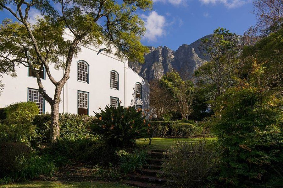 Originally a grain brewery, this impressive residence is set in the foothills of Table Mountain in Newlands, a 15-minute drive from the center of Cape Town.