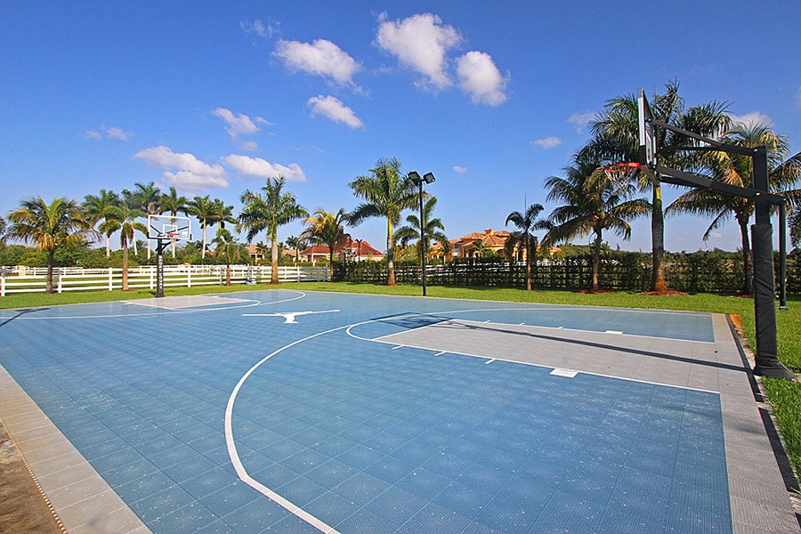 The kid-friendly amenities of this private and secure Florida estate include an arcade, playground, and lighted Air Jordan basketball court.