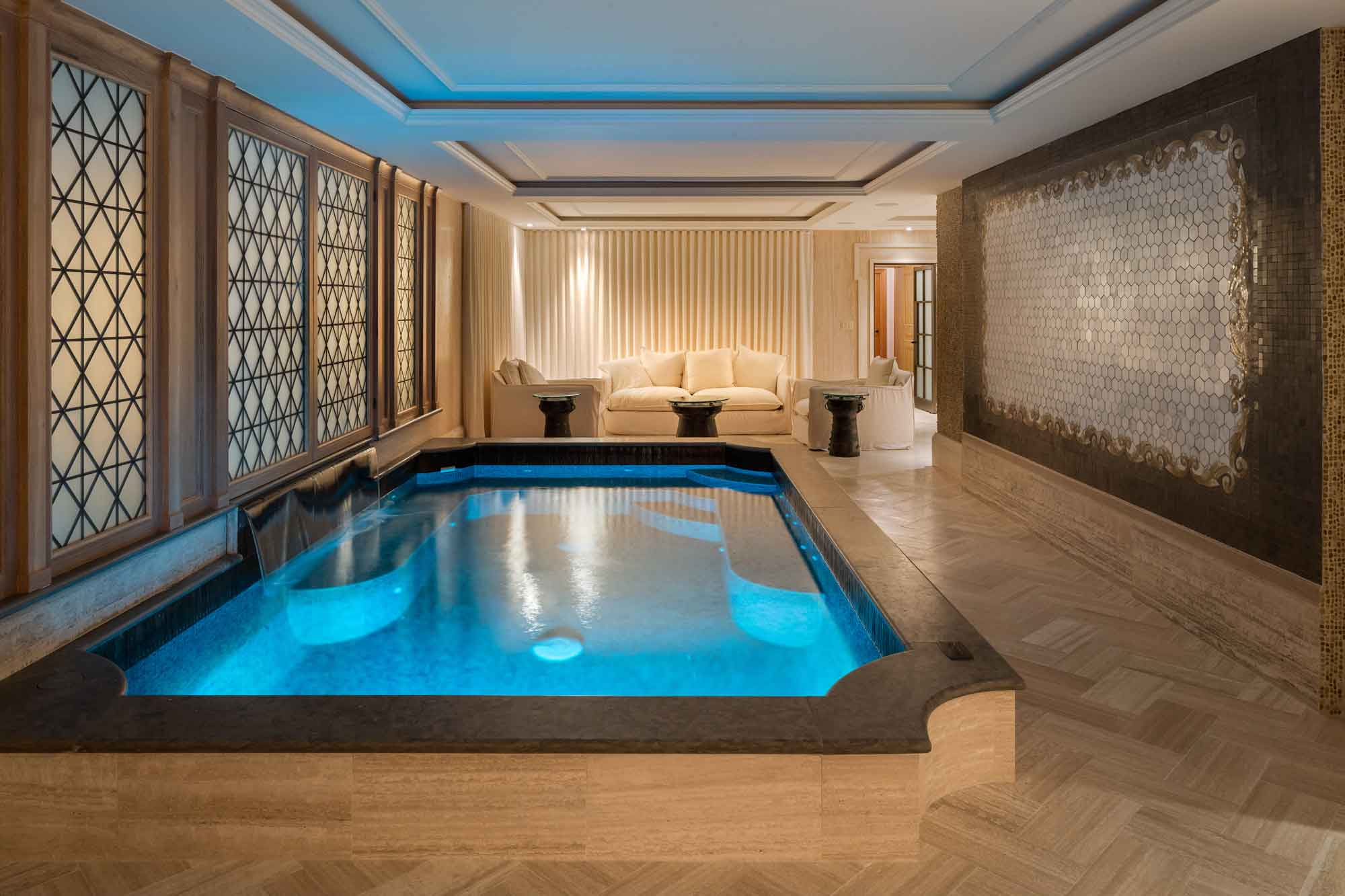 The luxury spa features a lap pool, a relaxation area, a steam room and sauna, a gym, and a massage room.