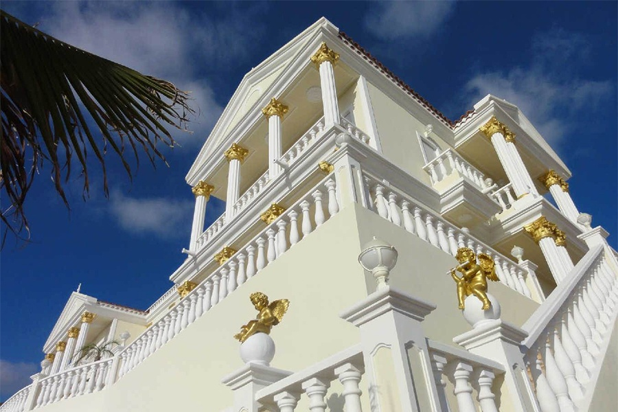 Gilded Corinthian columns and detailing adorn the soaring contemporary space within this magnificent Spanish villa.