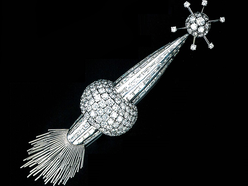"""Banner image: Van Cleef & Arpels' """"crater"""" cuffs, probably dating from the 1970s. Above: A diamond-set """"Sputnik"""" brooch dating from the 1950s, by Cartier."""