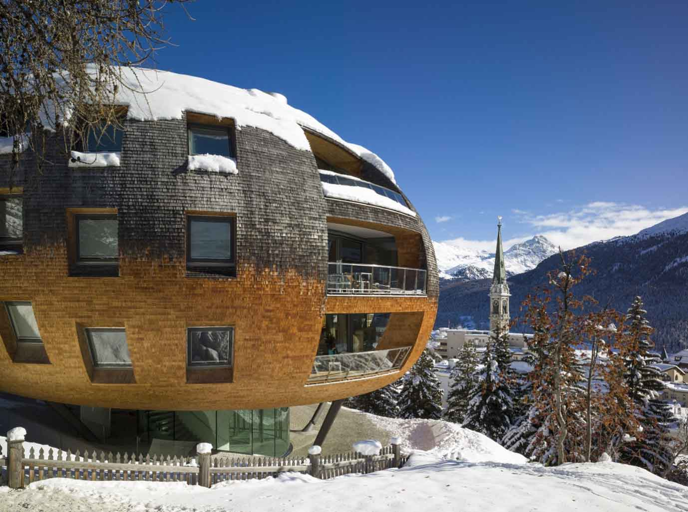 Chesa Futura (house of the future) is the innovative creation of Pritzker Prize-winning British architect Sir Norman Foster. The dynamic bubble-shaped building comprises five ultra-exclusive apartments overlooking the Swiss Alps and the village of St. Moritz.