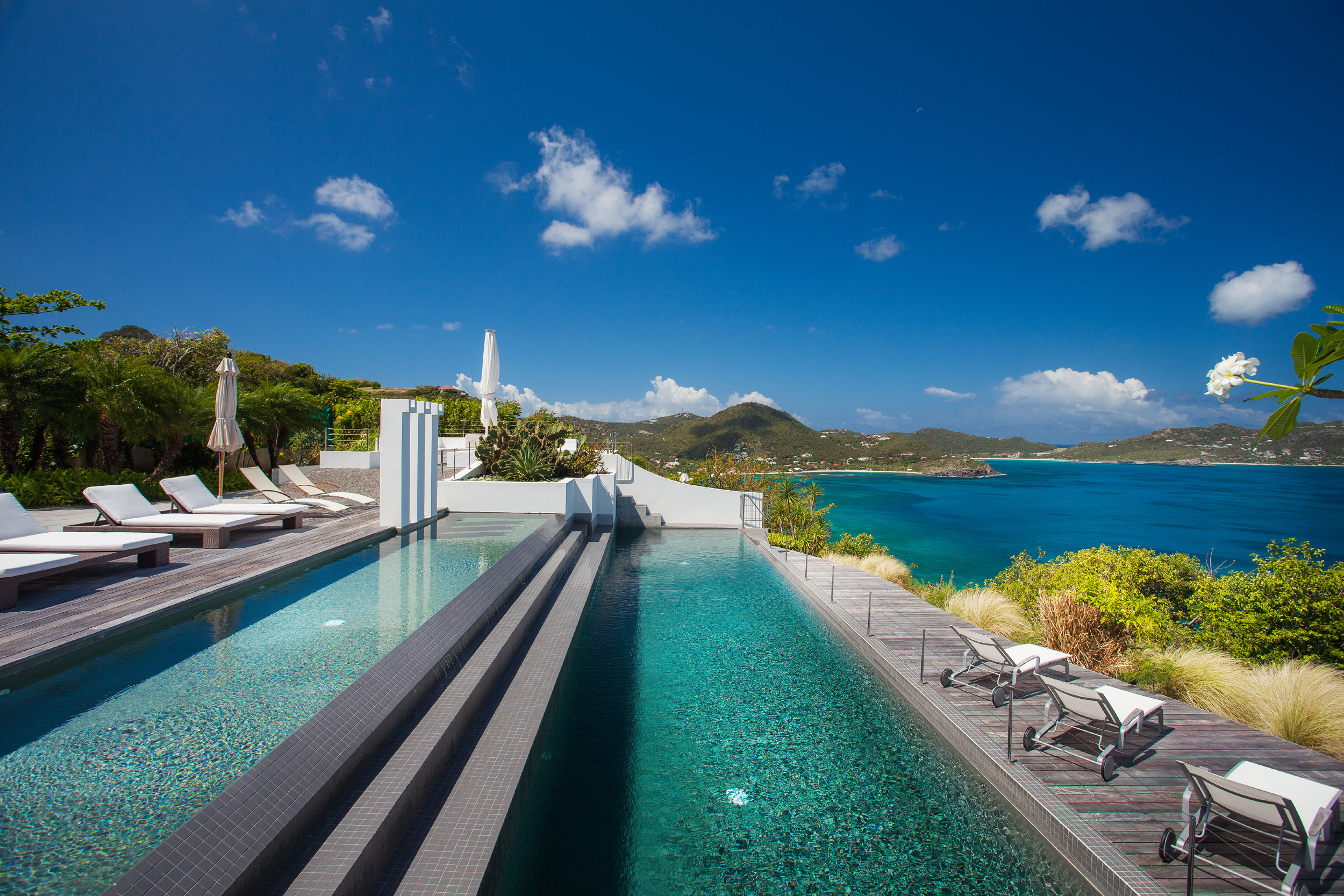 Villa DIC in Pointe Milou on the exclusive island of St. Barths in the French West Indies is a contemporary marvel at one with its lush, tropical environment.