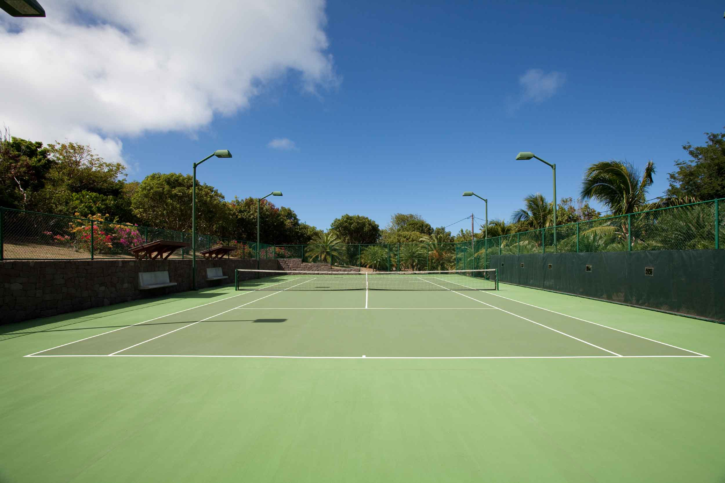 After a rousing set of tennis of the estate's lighted court, the shimmering pool beckons
