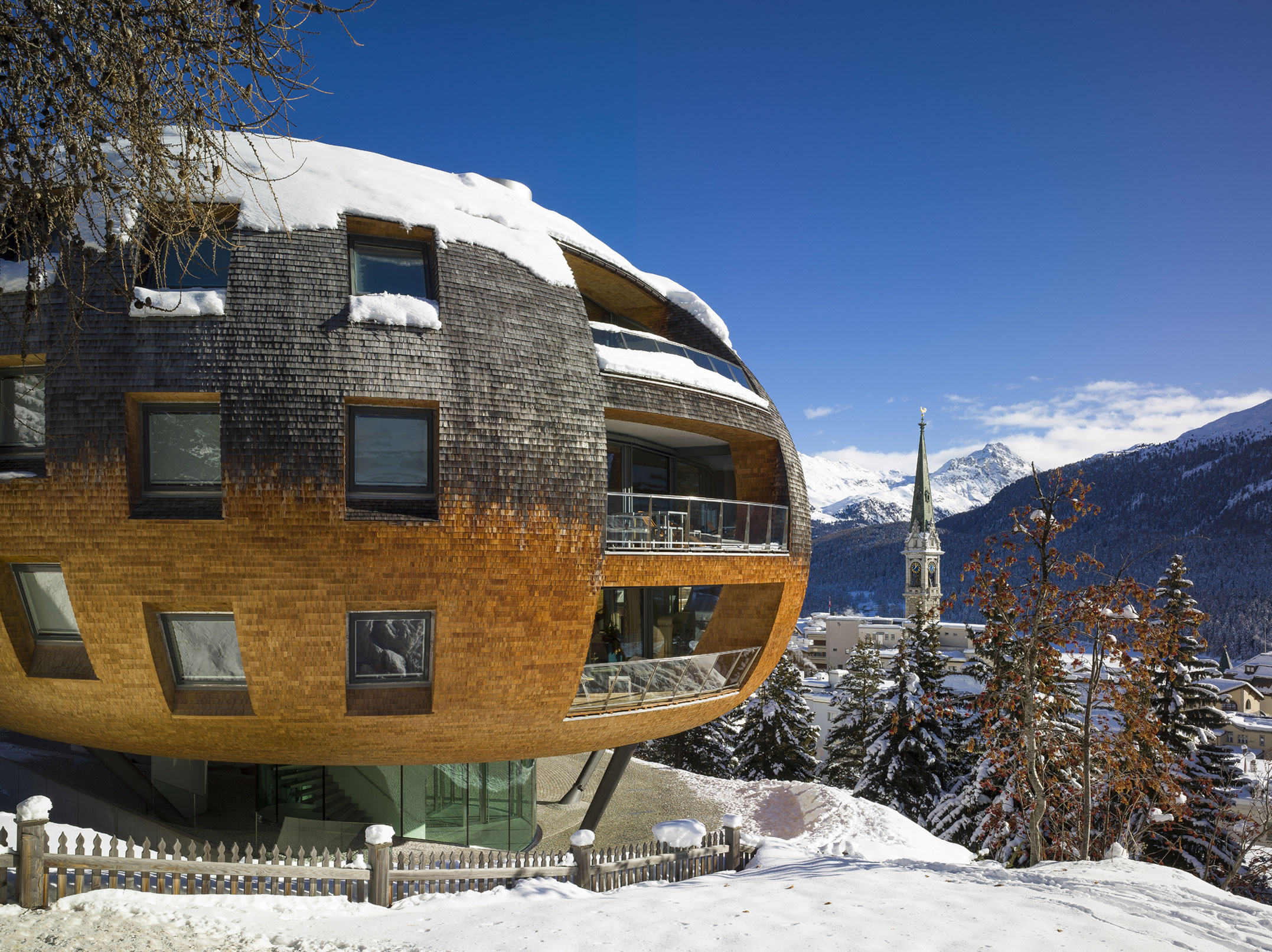 Chesa Futura, the creation of British architect Sir Norman Foster, has a prized location in St. Moritz. The world's first winter resort, this exclusive Alpine village has hosted the 1928 and 1948 Winter Olympics, and the 2017 Alpine World Ski Championships. St. Moritz's legendary champagne climate and traditional village atmosphere have been a draw for the cream of society since 1864.