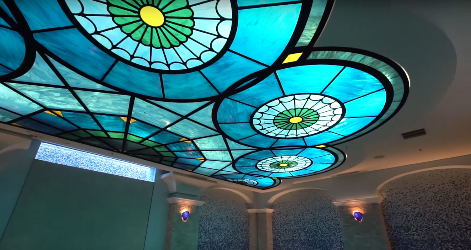 Casa Lago's indoor pool evokes the mystique of an Ancient Roman bath with its mosaic tiles, marble floors, and resplendent stained-glass skylight.