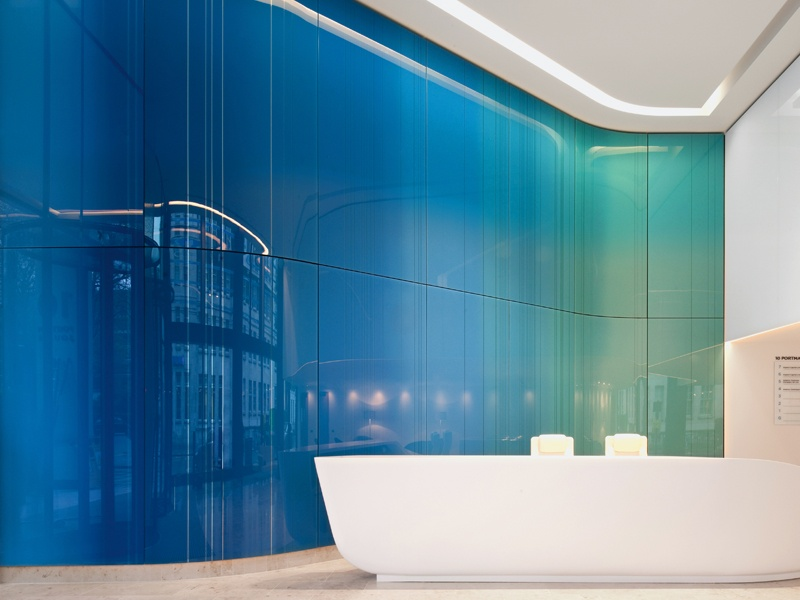 Work by the award-winning architectural glass artist Kate Maestri explores the possibilities of structural and three-dimensional contemporary stained glass, as seen in this curved, double-height ceramic enamel and mirrored glass wall in the reception of 10 Portman Square, London. Photograph: Philip Vile