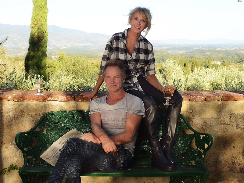 Sting and his film-producer wife Trudie Styler relaxing at Il Palagio, the Tuscan vineyard estate they bought in 1997 as a restoration project and family vacation home. The vineyard now boasts an award-winning Super Tuscan among its range of wines. Photograph: Jaime Travezan