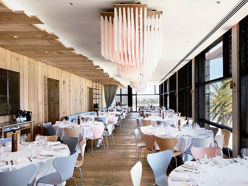 The striking light installation in the Stokehouse dining room was created by Mark Douglass and is made of 2,400 individual glass rods with a light-pink wash running through them. Photograph: Murray Fredericks